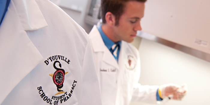 A pharmacist works in the lab.