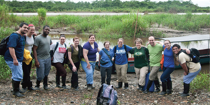 Students pose on a trip.
