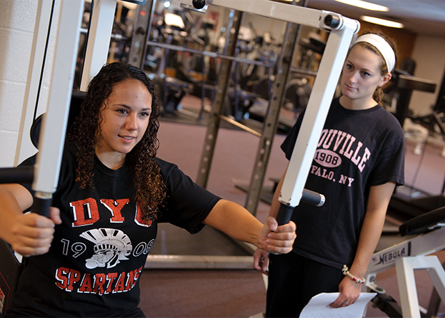 Students workout in the fitness center.